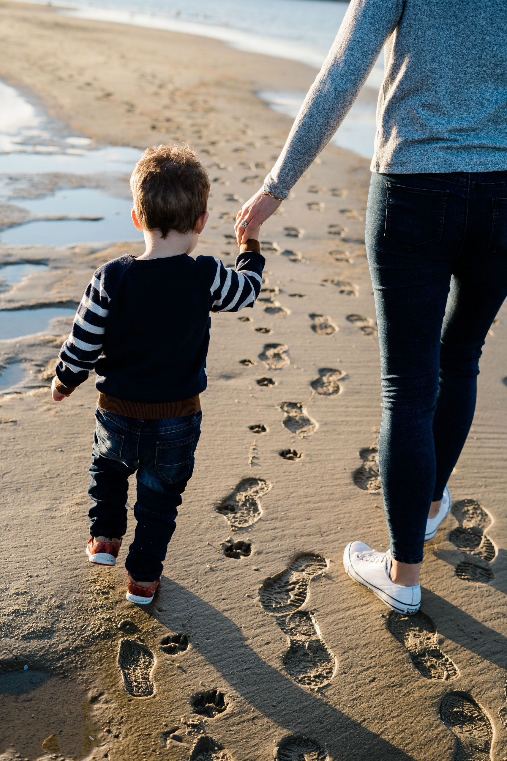 Mother and child walking on beach